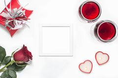Valentines Day with a glass of red wine, rose, gift, candles and heart view from above Stock Photography