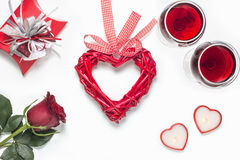 Valentines Day with a glass of red wine, rose, gift, candles view from above Stock Image