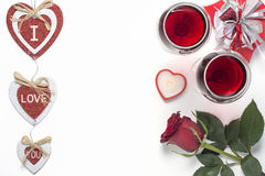 Valentines Day with a glass of red wine, rose, gift, candles view from above Stock Photos