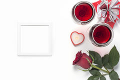 Valentines Day with a glass of red wine, rose, gift, candles view from above Royalty Free Stock Photo