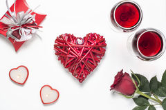 Valentines Day with a glass of red wine, rose, gift, candles view from above Royalty Free Stock Photos