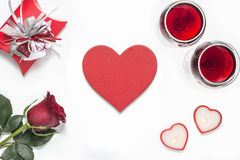 Valentines Day with a glass of red wine, rose, gift, candles view from above Royalty Free Stock Images