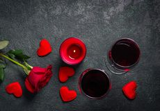 Valentines day greeting background. Wine glasses, rose and candl Royalty Free Stock Photography