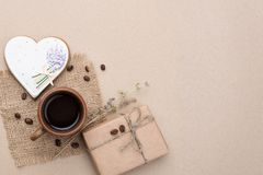Valentines day coffee. Valentines day greeting card with coffee, flowers craft gift box and heart shaped gingerbread on paper background Royalty Free Stock Photo