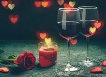 Valentines day greeting card concept. Wine glasses, rose and can Royalty Free Stock Photos