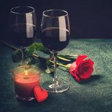 Valentines day greeting card concept. Wine glasses, rose and can Stock Photography