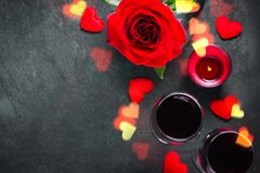Valentines day greeting card concept. Wine glasses, rose and candle Stock Images