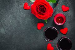 Valentines day greeting card concept. Wine glasses, rose and candle Royalty Free Stock Photo
