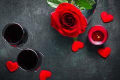 Valentines day greeting card concept. Wine glasses, rose and candle Royalty Free Stock Photos