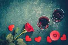 Valentines day greeting card concept. Wine glasses, rose and candle Stock Image