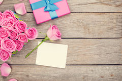 Valentines day greeting card and gift box full of pink roses Stock Photo