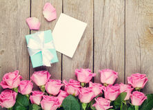 Valentines day greeting card, gift box and pink roses Stock Image