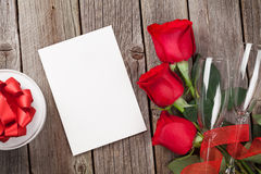 Valentines day greeting card, gift box and red roses Royalty Free Stock Photos