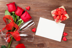 Valentines day greeting card, gift box and red roses Stock Photography