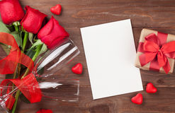 Valentines day greeting card, gift box and red roses Stock Photos