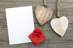 Valentines day greeting card and gift box on wooden table Royalty Free Stock Photography