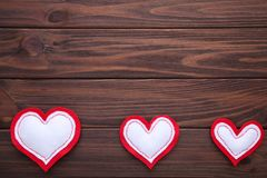 Valentines day greeting card. Handmaded hearts on brown background stock images