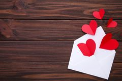 Valentines day greeting card. Handmaded red hearts in envelope on white background royalty free stock image