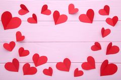 Valentines day greeting card. Handmaded red hearts on pink background stock photos