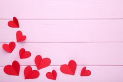 Valentines day greeting card. Handmaded red hearts on pink background royalty free stock photos