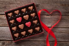 Valentines day greeting with heart chocolate box. Valentines day greeting card with heart chocolate box on wooden table. Top view Stock Photos