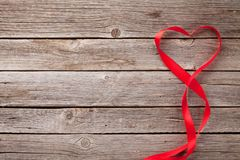 Valentines day greeting card and heart shaped ribbon Stock Photos