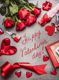 Valentines day greeting card with love symbols , red decoration and beautiful roses bunch, and handwritten lettering Happy Valenti. Nes day, top view, frame stock images
