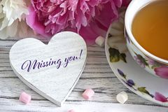 Valentines day greeting card with peonies tea cup marshmallow and lettering missing you. royalty free stock image