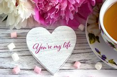 Valentines day greeting card with peonies tea cup marshmallow and lettering you are my life. Valentines day greeting card with peonies tea cup marshmallow and Stock Image