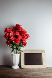 Valentines day greeting card. Red rose flowers and chalkboard on Royalty Free Stock Photography