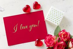 Valentines day greeting card with roses gift box hearts and lettering I love you. royalty free stock photos