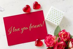 Valentines day greeting card with roses gift box hearts and lettering I love you forever. Valentines day greeting card with roses gift box hearts and lettering stock photos