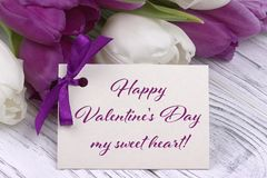 Valentines day greeting card, tulips white purple ribbon, white wooden background. Valentines day greeting card, tulips white purple ribbon, white wooden Royalty Free Stock Images