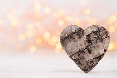 Valentines day greeting card. Wood heart on the light background Stock Photo