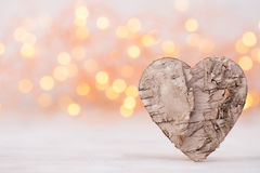 Valentines day greeting card. Wood heart on the light background Stock Photos