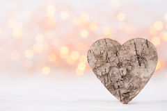 Valentines day greeting card. Wood heart on the light background Royalty Free Stock Photo