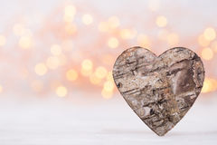 Valentines day greeting card. Wood heart on the light background Royalty Free Stock Images
