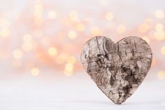 Valentines day greeting card. Wood heart on the light background Stock Images