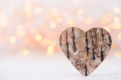 Valentines day greeting card. Wood heart on the light background Royalty Free Stock Photos