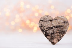 Valentines day greeting card. Wood heart on the light background Stock Photography