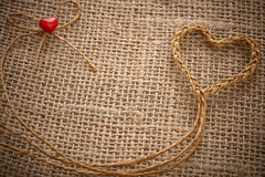 Valentines Day. Handmade Heart made of twine on sackcloth Stock Photo