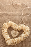 Love hearts, Valentines Day. Heart made of straw. Love hearts, Valentines Day. Heart handmade, made of bark and straw, decoration.  Vintage romantic style Royalty Free Stock Photo