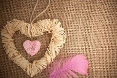 Love hearts, Valentines Day. Heart made of straw. Love hearts, Valentines Day. Heart handmade, made of bark and straw, decoration.  Vintage romantic style Stock Photo