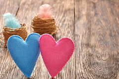 Love, Valentines Day. Hearts couple, wood. Vintage. Love, Valentines Day. Hearts couple Handmade and nests with feathers on wooden background. Vintage romantic Royalty Free Stock Images