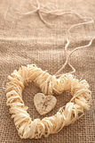Love hearts, Valentines Day. Heart made of straw. Love hearts, Valentines Day. Heart handmade, made of bark and straw, decoration.  Vintage romantic style Stock Images