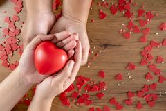 Valentines Day health care love holding red heart and world health day stock images