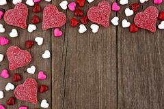 Valentines Day heart candy top corner border on rustic wood Royalty Free Stock Photography
