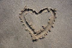 Valentines day heart drawn on sand Royalty Free Stock Photos