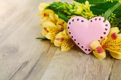 Valentines Day heart with flowers. Pink heart and flowers with place for text on the wooden background Stock Images