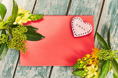 Valentines Day with heart. Heart and flowers with place for text on red background Stock Photo